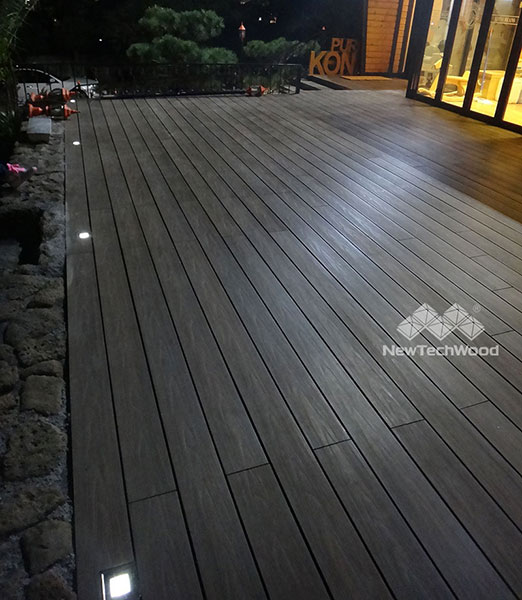 Nightview of outdoor Walnut deck