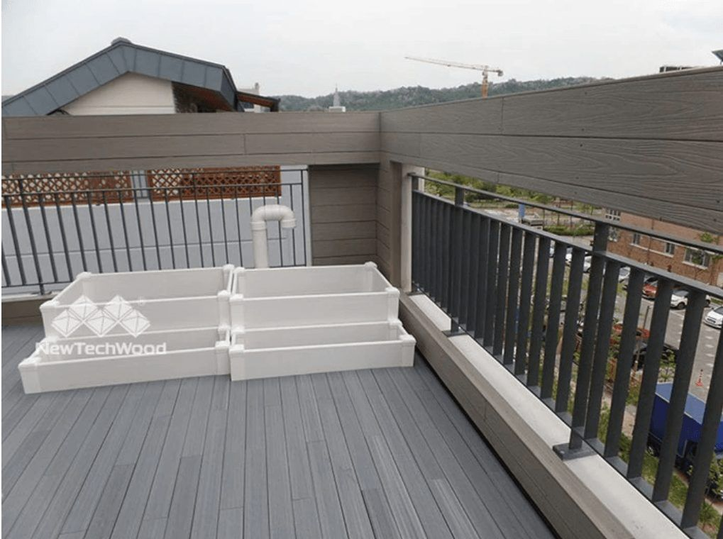 composite decks and safety fencing on roof top kids playground